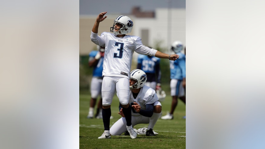 FILE -- In this July 31, 2014 file photo, Tennessee Titans kicker Maikon Bonani (3) watches a field goal attempt during a practice at NFL football training camp Thursday, July 31, 2014, in Nashville, Tenn. Bonani fell 35 feet from a theme park gondola in an accident that left him with broken vertebra in his back and cost him a season at South Florida. Now the native of Brazil is in Tennessee for a second training camp and competing to be the Titans' new kicker. (AP Photo/Mark Humphrey, File)