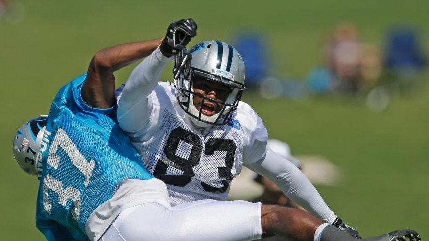 Carolina Panthers' Carrinton Byndom (37) breaks up a pass intended for Marcus Lucas (83) during an NFL football practice at their training camp in Spartanburg, S.C., Monday, July 28, 2014. (AP Photo/Chuck Burton)