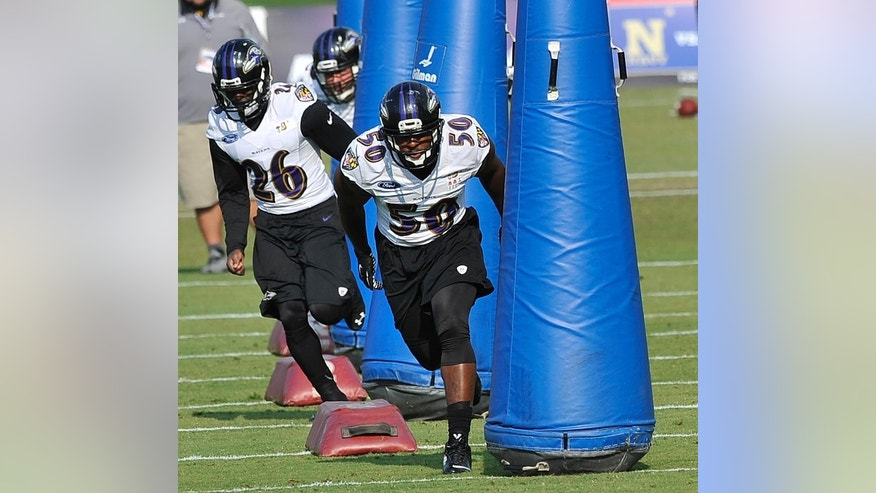 Baltimore Ravens defensive players Matt Elam (26) and Albert McClellan (50)  run a drill during NFL football training camp practice, Thursday, July 31, 2014, in Owings Mills, Md.(AP Photo/Gail Burton)