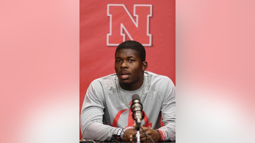 Nebraska quarterback Tommy Armstrong speaks during a media availability event in Lincoln, Neb., Friday, Aug. 1, 2014. Nebraska goes into the 2014 season looking to become relevant again nationally. The Cornhuskers finished 2013 outside the Top 25 for the first time since 2008, and they haven't ended a season in the top 10 since 2001. This year Wisconsin and Iowa are picked to finish ahead of the Huskers in the new West Division. (AP Photo/Nati Harnik)