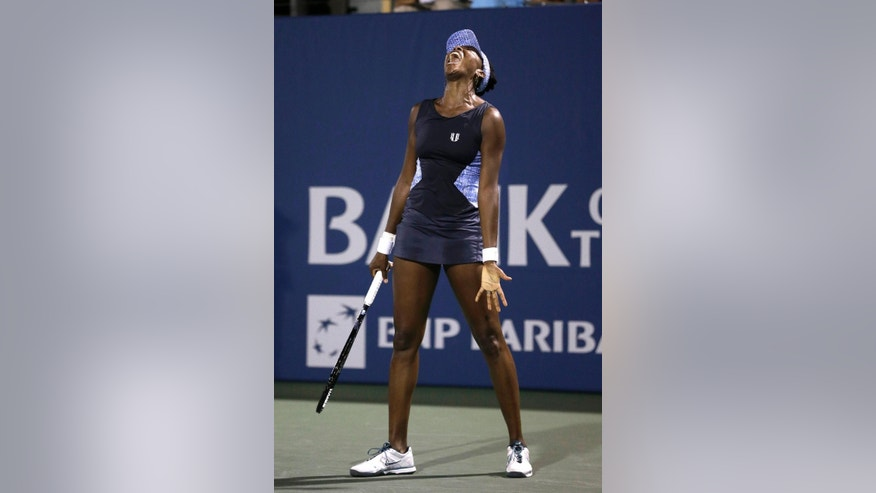 Venus Williams reacts after losing a point to Victoria Azarenka, from Belarus, during the second set of their match in the Bank of the West Classic tennis tournament in Stanford, Calif., Thursday, July 31, 2014. Williams won 6-4, 7-6(1). (AP Photo/Jeff Chiu)