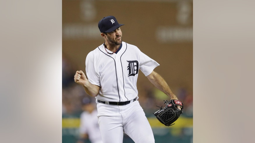Detroit Tigers starting pitcher Justin Verlander reacts after striking out Colorado Rockies' Charlie Blackmon to end the top of the seventh inning of an interleague baseball game, Friday, Aug. 1, 2014, in Detroit. (AP Photo/Carlos Osorio)