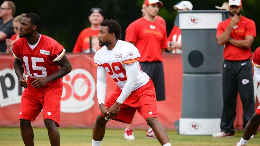 Kansas City Chiefs safety Eric Berry, center, and wide receiver A.J. Jenkins, left, stretch on the side without pads during an NFL training camp practice at Missouri Western State University in St. Joseph, Mo., Friday, Aug. 1, 2014.  (AP Photo/The St. Joseph News-Press, Sait Serkan Gurbuz)   MANDATORY CREDIT