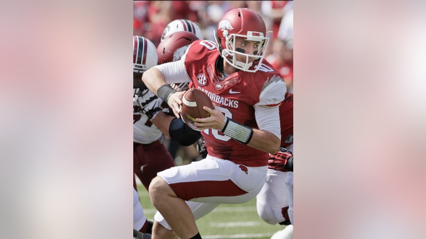 In this photo taken Oct. 12, 2013, Arkansas quarterback Brandon Allen plays during the second quarter of an NCAA college football game against South Carolina in Fayetteville, Ark. Much of the Razorbacks' hopes fall this season on the expected improvement of quarterback Allen, who battled injuries for much of last season. (AP Photo/Danny Johnston)