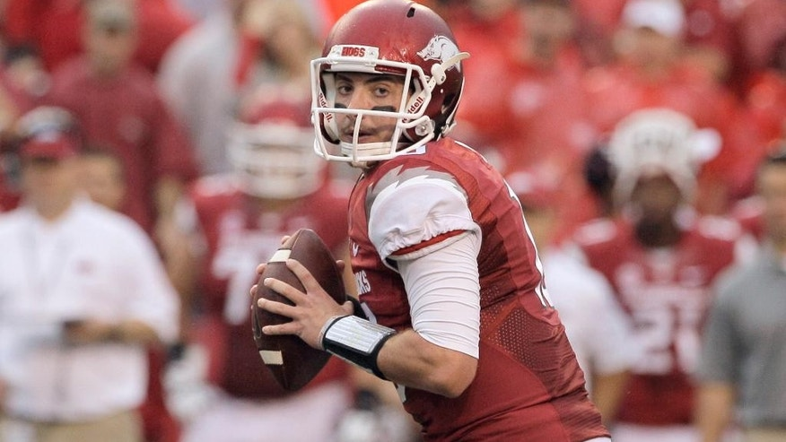 FILE - In this file photo taken Sept. 28, 2013, Arkansas quarterback Brandon Allen prepares to pass during the first quarter of an NCAA college football game against Texas A&M in Fayetteville, Ark. Much of Arkansas' hopes this season depend on the expected improvement of quarterback Allen. (AP Photo/Danny Johnston, File)