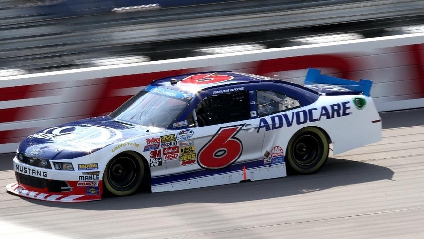 Trevor Bayne drives during qualifying for the NASCAR Nationwide series auto race at Iowa Speedway in Newton, Iowa, Saturday, Aug 2, 2014. Bayne won the pole. (AP Photo/Justin Hayworth)