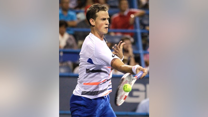 Vasek Pospisil, of Canada, returns the ball to Berdych, of the Czech Republic, at the Citi Open tennis tournament, Thursday, July 31, 2014, in Washington. (AP Photo/Luis M. Alvarez)