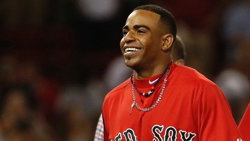 Boston Red Sox's Yoenis Cespedes smiles after the Red Sox defeated the New York Yankees 4-3 in a baseball game at Fenway Park in Boston on Friday, Aug. 1, 2014. (AP Photo/Winslow Townson)