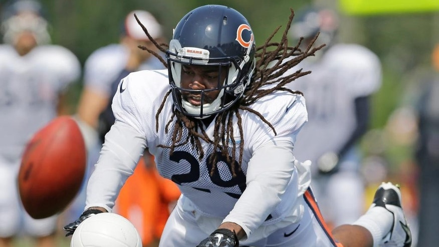 Chicago Bears safety Danny McCray (29) blocks a ball during NFL football training camp at Olivet Nazarene University, Wednesday, July 30, 2014, in Bourbonnais, Ill. (AP Photo/Nam Y. Huh)