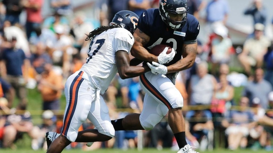 Chicago Bears safety M.D. Jennings (37), left, tackles fullback Tony Fiammetta (43) during NFL football training camp at Olivet Nazarene University, Wednesday, July 30, 2014, in Bourbonnais, Ill. (AP Photo/Nam Y. Huh)