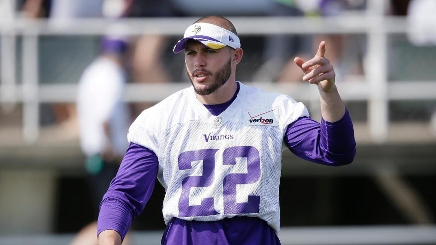 Minnesota Vikings free safety Harrison Smith directs teammates during an NFL football training camp practice, Saturday, Aug. 2, 2014, in Mankato, Minn. (AP Photo/Charlie Neibergall)