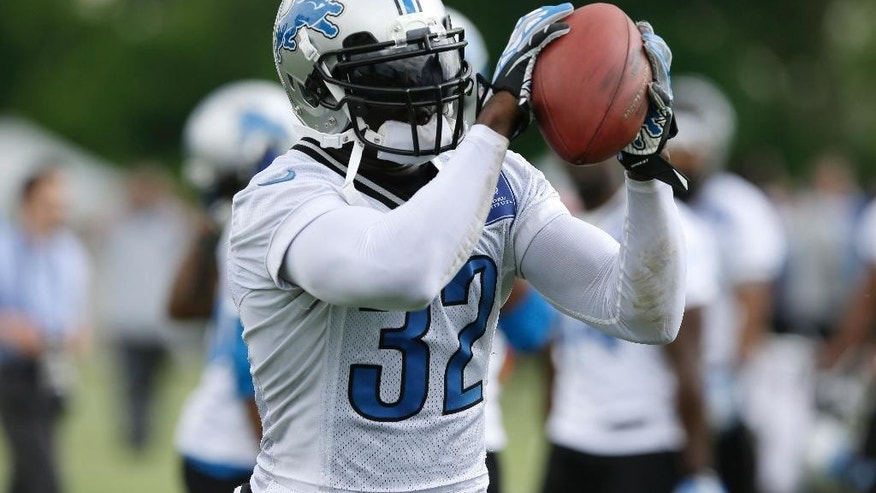 FILE- In a June 11, 2014 file photo Detroit Lions safety James Ihedigbo runs through a drill during an NFL football minicamp in Allen Park, Mich. Safety seems to be a position of strength for the Lions with newcomer Ihedigbo and veteran Glover Quin. (AP Photo/Carlos Osorio, File)