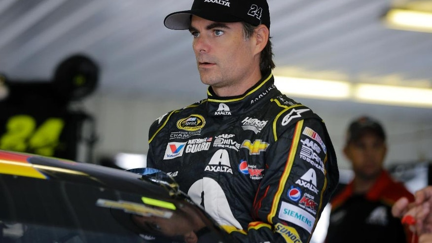 Jeff Gordon climbs into his race car for a practice session for Sunday's NASCAR Sprint Cup Series auto race at Pocono Raceway, Saturday, Aug. 2, 2014, Long Pond, Pa. (AP Photo/Mel Evans)