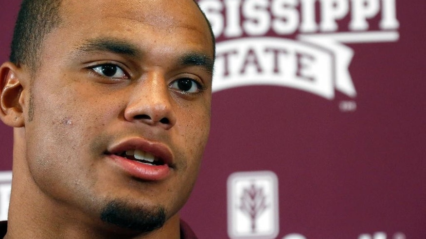 Mississippi State quarterback Dak Prescott responds to a reporter's question during the NCAA college football team's media day, Saturday, Aug. 2, 2014, in Starkville, Miss. (AP Photo/Rogelio V. Solis)