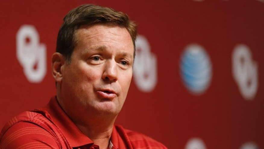 Oklahoma head coach Bob Stoops answers a question during Media Day in Norman, Okla., Saturday, Aug. 2, 2014. (AP Photo/Sue Ogrocki)