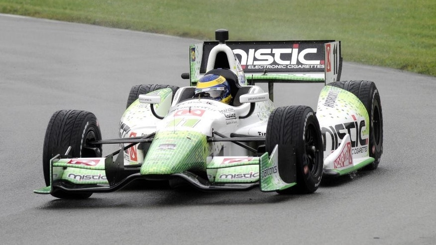 Sebastien Bourdais, of France, takes a lap during qualifying for Sunday's IndyCar Honda Indy 200 auto race at Mid-Ohio Sports Car Course in Lexington, Ohio, Saturday, Aug. 3, 2014. Bourdais won the pole. (AP Photo/Tom E. Puskar)