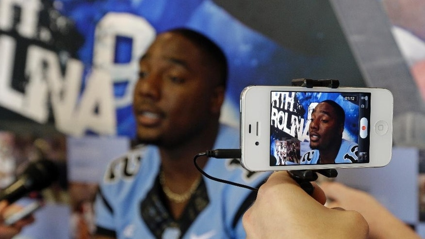 North Carolina quarterback Marquise Williams is interviewed during an NCAA football media day in Chapel Hill, N.C., Saturday, Aug. 2, 2014. (AP Photo/Gerry Broome)
