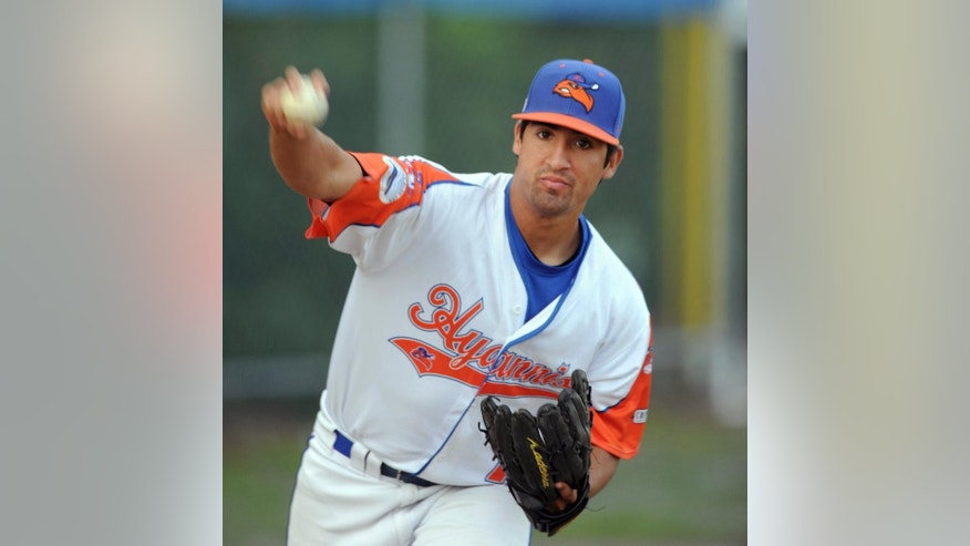 In this Wednesday, July 30, 2014 photo, Hyannis pitcher Ryan Perez, of Hampshire, Ill., pitches with his right hand during warm-ups before a Cape Cod Baseball League game in Hyannis, Mass. The 20-year-old ambidextrous pitcher from tiny Judson University has blossomed into a potential high-round pick for the 2015 draft with his performances this summer in the prestigious Cape Cod League. (AP Photo/Cape Cod Times, Ron Schloerb) MANDATORY CREDIT: CAPE COD TIMES/RON SCHLOERB