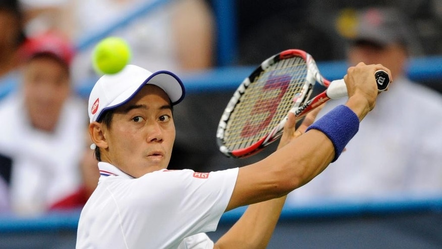 Kei Nishikori, of Japan, eyes the ball during a match against Richard Gasquet, of France, at the Citi Open tennis tournament, Friday, Aug. 1, 2014, in Washington. Gasquet won 6-1, 6-4. (AP Photo/Nick Wass)