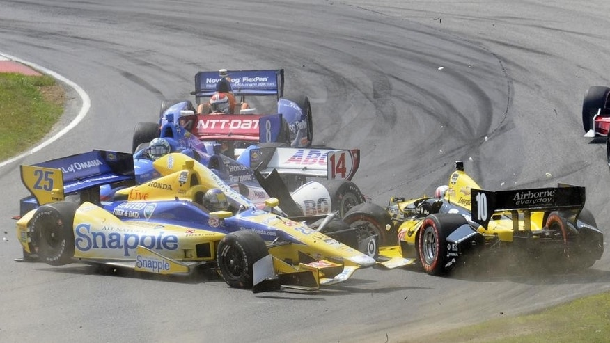 Marco Andretti (25) collides with Tony Kanaan (10), of Brazil, in a first lap crash during the IndyCar Honda Indy 200 auto racing at Mid-Ohio Sports Car Course in Lexington, Ohio Sunday, Aug. 3, 2014, while Takuma Sato (14), of Japan, and Ryan Briscoe (8), of Australia, try to avoid the crash. (AP Photo/Tom E. Puskar)