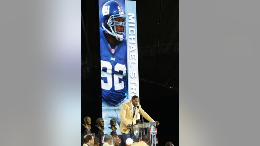 Hall of Fame inductee Michael Strahan speaks during the Pro Football Hall of Fame enshrinement ceremony at the Pro Football Hall of Fame on Saturday, Aug. 2, 2014, in Canton, Ohio. (AP Photo/Tony Dejak)