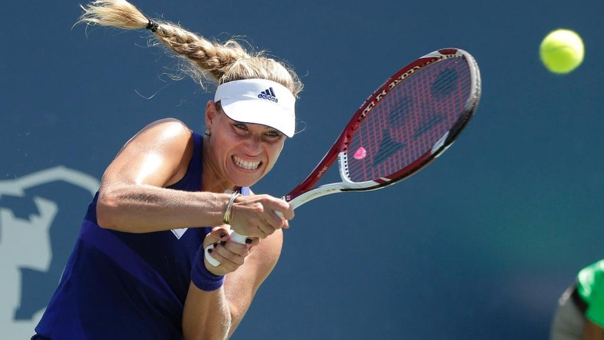 Angelique Kerber, of Germany, returns to Serena Williams during the championship match of the Bank of the West Classic tennis tournament on Sunday, Aug. 3, 2014, in Stanford , Calif. (AP Photo/Marcio Jose Sanchez)