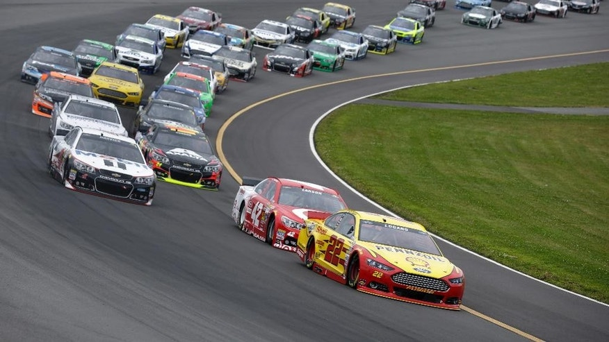 Joey Logano (22) leads Kyle Larson (42) on an early restart during the NASCAR Sprint Cup Series auto race at Pocono Raceway, Sunday, Aug. 3, 2014, Long Pond, Pa. (AP Photo/Mel Evans)
