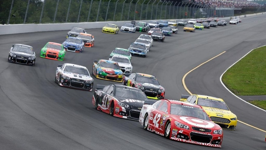 Kyle Larson (42) leads a pack of cars at the start of the NASCAR Sprint Cup Series auto race at Pocono Raceway, Sunday, Aug. 3, 2014, Long Pond, Pa. (AP Photo/Mel Evans)