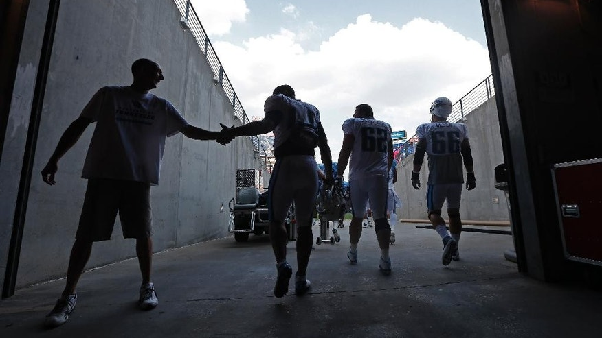 Tennessee Titans players enter LP Field for an NFL football training camp practice on Saturday, Aug. 2, 2014, in Nashville, Tenn. (AP Photo/Mark Humphrey)