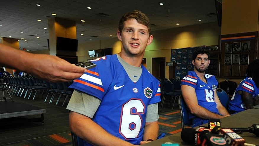 Florida NCAA college football quarterback Jeff Driskel (6) talks with reporters during Media Day at the University of Florida in Gainesville, Fla.,  Sunday, Aug. 3, 2014,  as quarterback Mornhinweg Skyler (8) looks on. (AP Photo/Phil Sandlin)