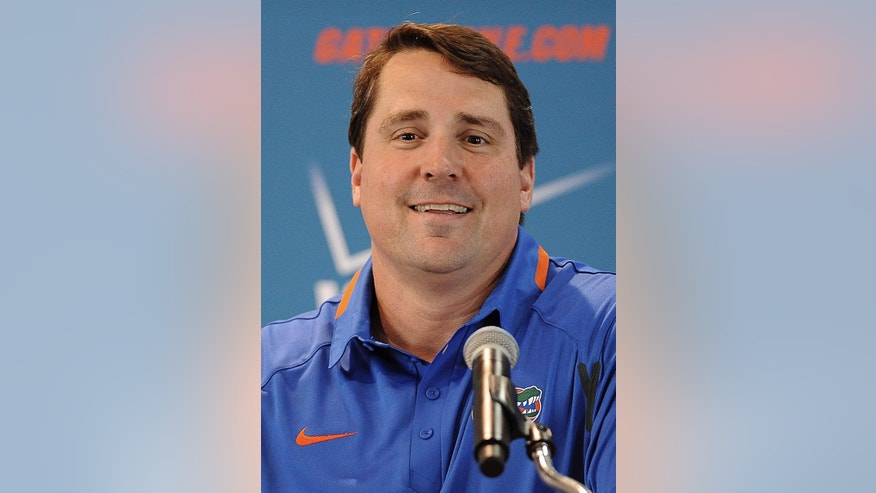 Florida NCAA college head football coach Will Muschamp smiles at the teams media day in Gainesville, Fla., Sunday, Aug. 3, 2014.  (AP Photo/Phil Sandlin)