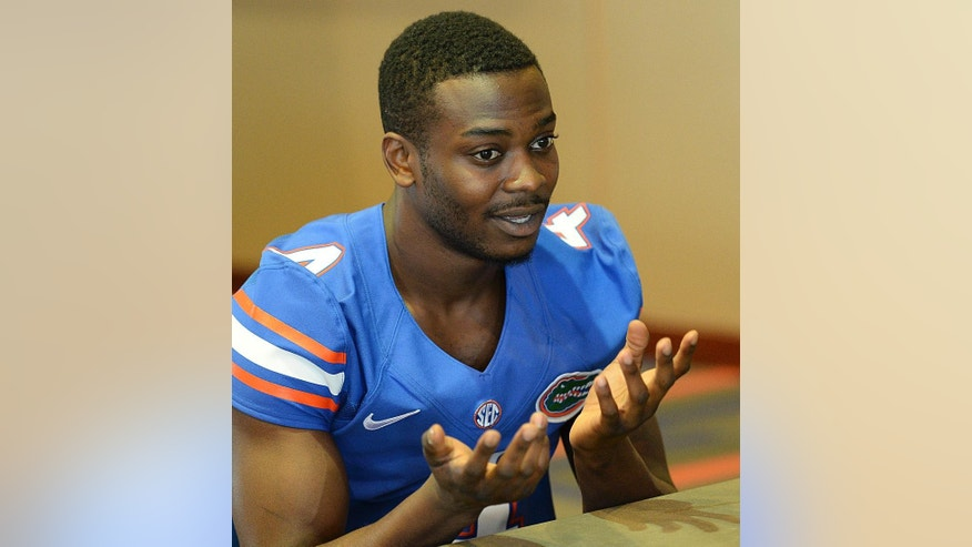 Florida NCAA college football wide receiver Andre Debose talks with reporters during Media Day in Gainesville, Fla.,  Sunday, Aug. 3, 2014.  (AP Photo/Phil Sandlin)