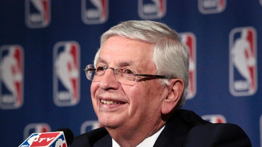FILE - In this Oct. 23, 2013 file photo, NBA Commissioner David Stern smiles during a news conference after an NBA board of governors meeting in New York. Stern is amazed when he looks at the NBA and compares it to the league that was struggling to stay afloat when he started.  (AP Photo/Bebeto Matthews, File)