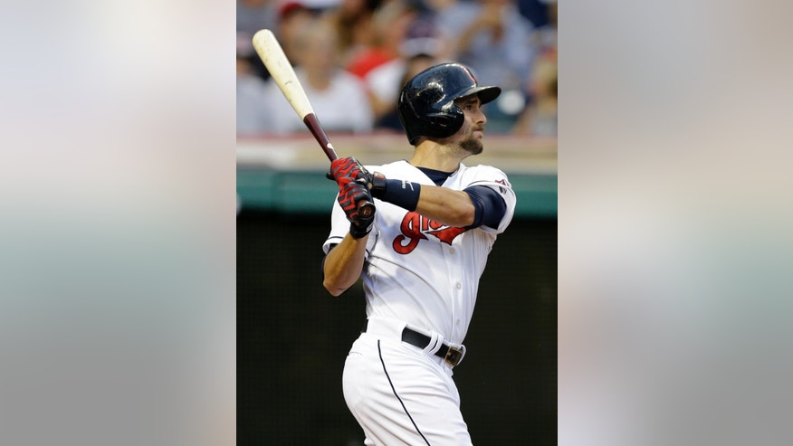 Cleveland Indians' Lonnie Chisenhall watches his three-run home run off Cincinnati Reds starting pitcher Alfredo Simon in the fourth inning of a baseball game Monday, Aug. 4, 2014, in Cleveland. (AP Photo/Mark Duncan)