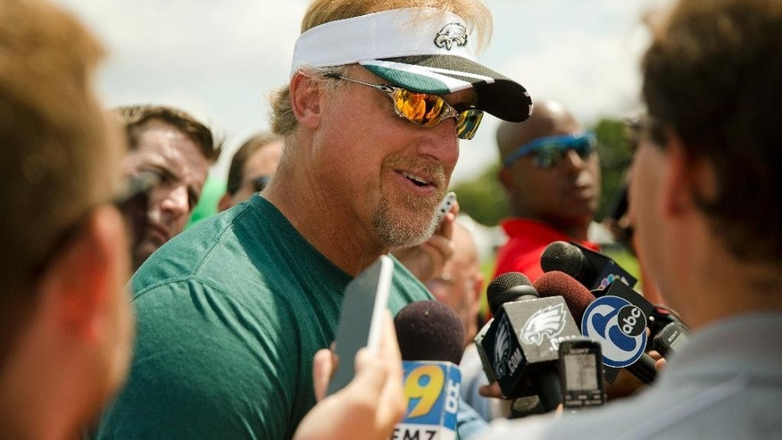 Guest coach Kevin Greene speaks with members of the media during the Philadelphia Eagles' NFL football training camp Monday, Aug. 4, 2014, in Philadelphia. (AP Photo/Matt Rourke)