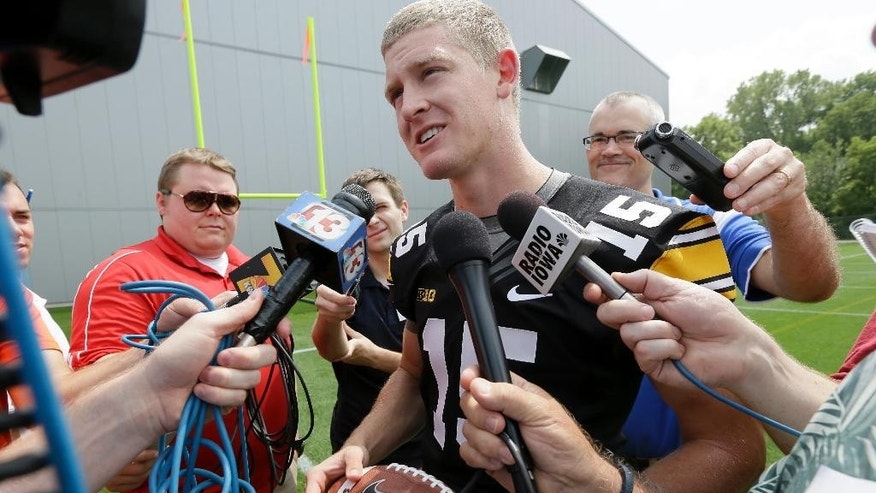 Iowa quarterback Jake Rudock (15) speaks to the media during Iowa's annual college football media day, Monday, Aug. 4, 2014, in Iowa City, Iowa. (AP Photo/Charlie Neibergall)