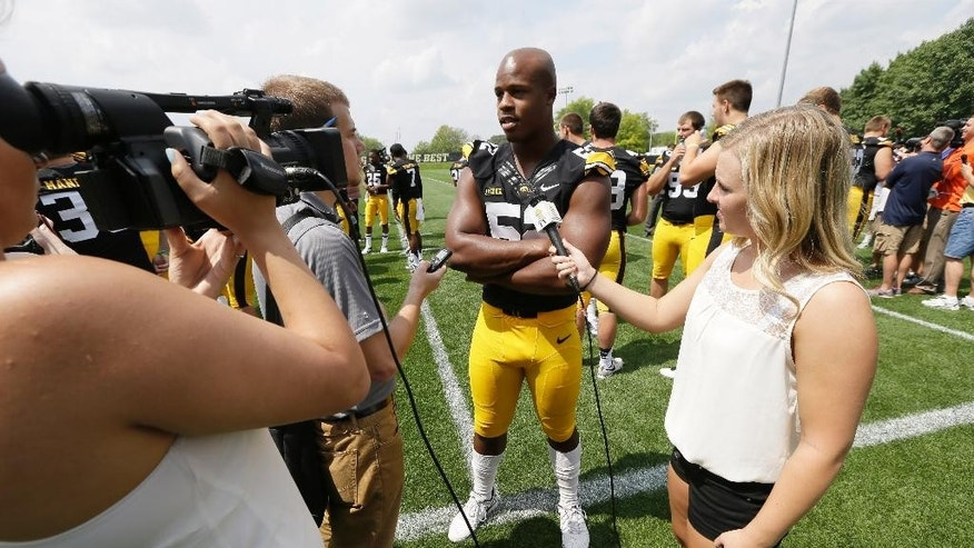 Iowa linebacker Quinton Alston (52) speaks to the media during Iowa's annual college football media day, Monday, Aug. 4, 2014, in Iowa City, Iowa. (AP Photo/Charlie Neibergall)