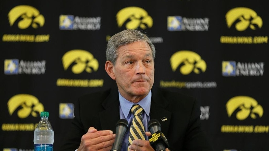 Iowa head coach Kirk Ferentz speaks to the media during Iowa's annual college football media day, Monday, Aug. 4, 2014, in Iowa City, Iowa. (AP Photo/Charlie Neibergall)