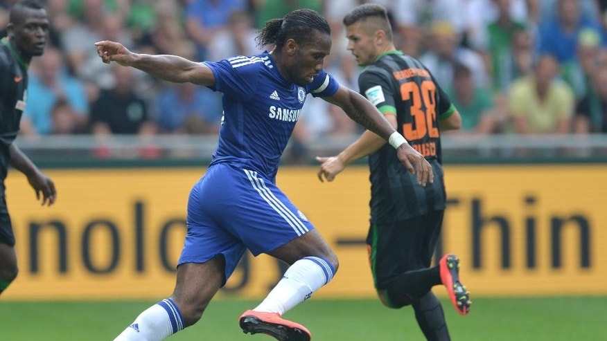Chelsea's Didier Drogba plays the ball during  the preseason  soccer match between SV  Werder Bremen and FC Chelsea   in Bremen, Germany,  Sunday Aug. 3, 2014. Bremen won by 3-0.  (AP Photo/dpa, Carmen  Jaspersen)