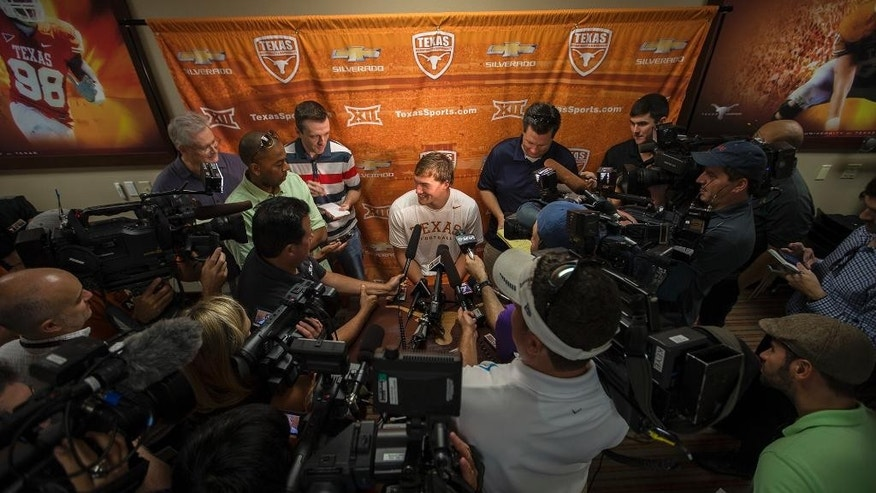 Texas NCAA college football quarterback David Ash speaks to the media during a press conference after practice on Monday, Aug. 4, 2014.  (AP Photo/Austin American-Statesman, Ricardo B. Brazziell)  AUSTIN CHRONICLE OUT, COMMUNITY IMPACT OUT, INTERNET AND TV MUST CREDIT PHOTOGRAPHER AND STATESMAN.COM, MAGS OUT
