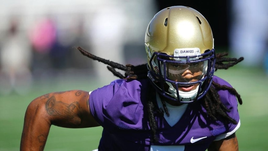 Washington linebacker Shaq Thompson runs through a drill during the first session of NCAA college football practice before the upcoming fall season, Monday, Aug. 4, 2014, in Seattle. (AP Photo/Ted S. Warren)