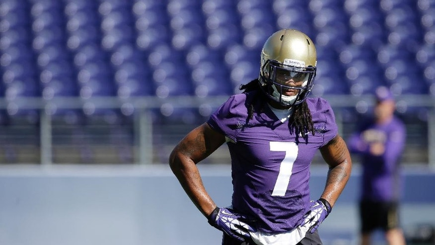Washington linebacker Shaq Thompson rests after taking part in a drill during the first session of NCAA college football practice before the upcoming fall season, Monday, Aug. 4, 2014, in Seattle. (AP Photo/Ted S. Warren)