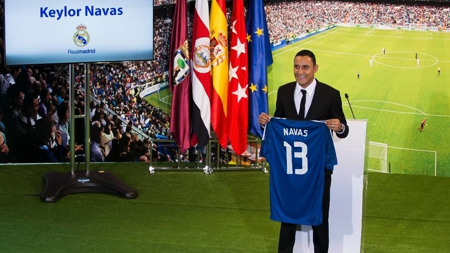 Costa Rica international soccer player Keylor Navas, poses during his official presentation at the Santiago Bernabeu stadium in Madrid, Spain, Tuesday, Aug. 5, 2014, after signing for Real Madrid. (AP Photo/Andres Kudacki)