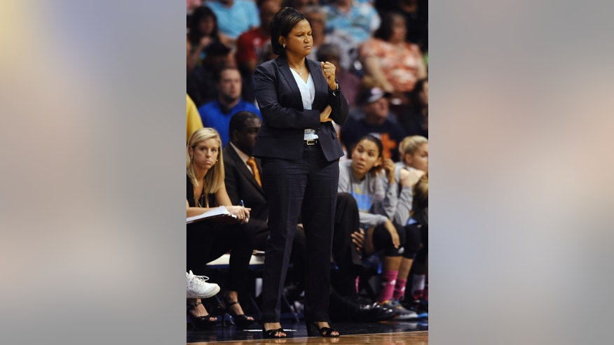 Chicago Sky head coach Pokey Chatman reacts during the second half of a WNBA basketball game against the Connecticut Sun, Tuesday, Aug. 5, 2014, in Uncasville, Conn. The Sky won 82-66. (AP Photo/Jessica Hill)