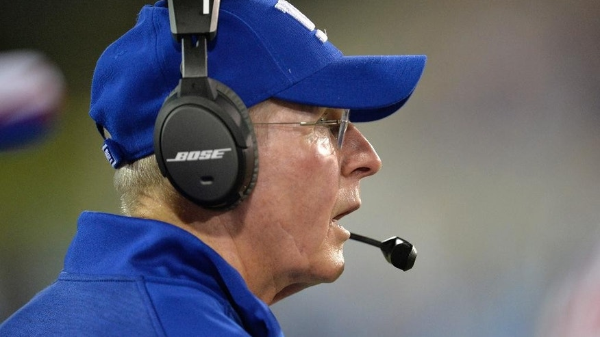 New York Giants head coach Tom Coughlin watches in the second quarter of the Pro Football Hall of Fame exhibition NFL football game against the Buffalo Bills, Sunday, Aug. 3, 2014, in Canton, Ohio. (AP Photo/David Richard)