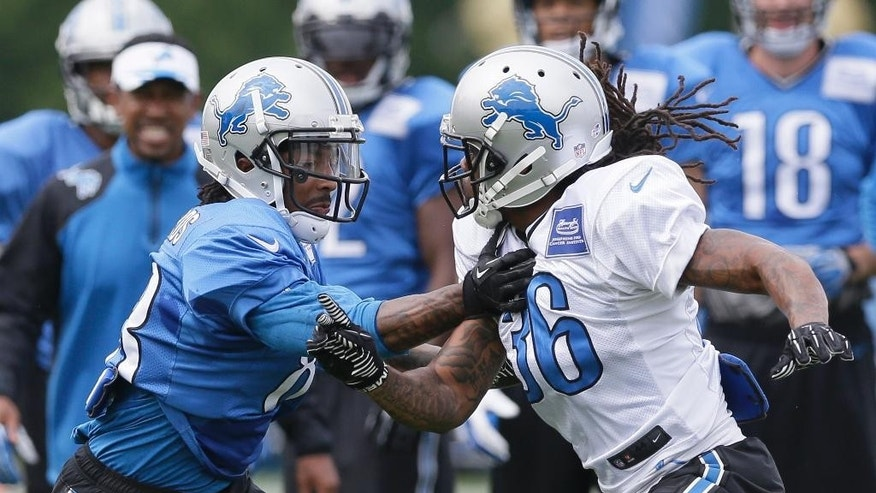 Detroit Lions cornerback Jonte Green (36) covers wide receiver Pat Edwards during an NFL football training camp in Allen Park, Mich., Tuesday, Aug. 5, 2014. (AP Photo/Carlos Osorio)