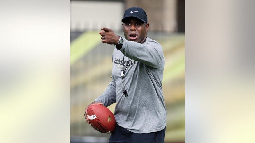 FILE -- In this July 31, 2014, file photo, Vanderbilt head coach Derek Mason directs players during an NCAA college football practice in Nashville, Tenn. Vanderbilt coaches have been doing their best to give all six quarterbacks a chance to make a good impression in the opening days of camp. (AP Photo/Mark Humphrey, File)