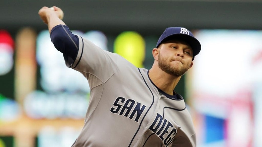 San Diego Padres pitcher Jesse Hahn throws against the Minnesota Twins in the first inning of a baseball game, Tuesday, Aug. 5, 2014, in Minneapolis. (AP Photo/Jim Mone)