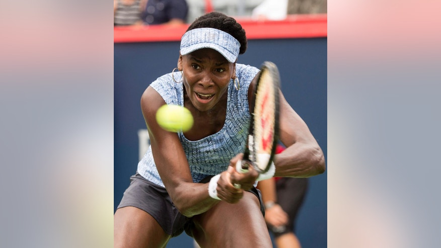 Venus Williams returns to Anastasia Pavlyuchenkova, of Russia,  during her first round match at the Rogers Cup tennis tournament in Montreal on Tuesday, Aug. 5, 2014. (AP Photo/The Canadian Press, Paul Chiasson)