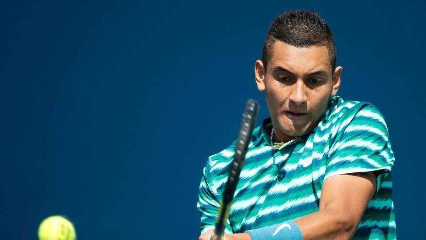 Nick Kyrgios of Australia returns the ball against Andy Murray of Great Britain during a men's third round match at the Rogers Cup tennis tournament in Toronto on Wednesday, Aug. 6, 2014. (AP Photo/The Canadian Press, Nathan Denette)